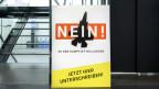 Ein Plakat zur Lancierung des Referendums «Nein zu den Kampfjet-Milliarden».