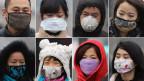In China schützen sich die Menschen mit Gesichtsmasken.