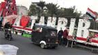 Ein Tuk-Tuk auf dem Tahrir-Platz in Bagdad. Die Dreirad-Taxis sind zum Symbol der irakischen Proteste geworden.