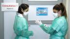 Zwei Mitarbeiterinnen des Universitätsspitals Lausanne rüsten sich für das Corona-Virus.