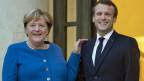 Die deutsche Bundeskanzlerin Angela Merkel und der französische Präsident Emmanuel Macron an einem Treffen im Elysee-Palast in Paris.
