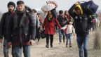 Migranten auf der Flucht in Richtung der türkisch-griechische Grenze.