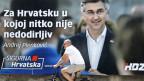Ein Velofahrer vor einem riesigen Wahlplakat mit einem Bild des kroatischen Ministerpräsidenten Andrej Plenkovic in Zagreb, Kroatien.