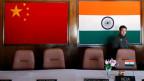 Indiens und Chinas Flagge.