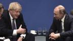 Der britische Premierminister Boris Johnson (links) spricht mit dem russischen Präsidenten Wladimir Putin während der Internationalen Libyen-Konferenz in Berlin, Deutschland, am 19. Januar 2020.