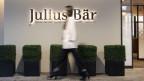 Banken wie Julius Bär und UBS, die den Vermögenden bei ihren Börsengeschäften zur Seite stehen, verdienen kräftig mit.
