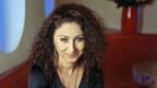 Sie Schriftstellerin Güzin Kar.