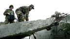 In eingestürzten Gebäuden nach Überlebenden suchen - eine frühere Übung der Katastrophenhilfe in der Nähe von Genf.