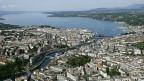 Blick auf Genf mit der Rhone und dem Genfersee.