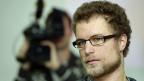 Greenpeace-Aktivist Marco Weber an der Medienkonferenz nach seiner Rückkehr in die Schweiz.