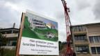 Mit der Massnahme soll der Immobilienmarkt stabilisiert werden. Bild: Baustelle in Meggen LU.