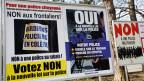 Abstimmungsplakate für und gegen das neue Polizeigesetz über das am 8. März 2015 abgestimmt wurde.
