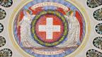In der Eingangshalle des Bundeshauses steht im Zentrum der im Kreis angeordneten Kantonswappen «Unis pro Omnibus - Omnes pro Uno» - Sinnbild für den Föderalismus in der Schweiz.