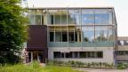 Das «House of Natural Resources» auf dem Campus der ETH Zürich in Höngg. Bauen mit Laubholz benötigt wenig Material;  es ist zugleich hart und leicht und eignet sich daher besonders fürs Bauen in die Höhe.