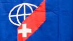 Noch nie hat ein Auslandschweizer oder eine Auslandschweizerin  den Sprung ins Schweizer Parlament geschafft. Bild: Die Fahne der Auslandschweizerorganisation ASO.
