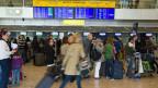 Check-In-Schalter am Flughafen Genf Cointrin.