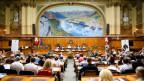Teilnehmer des Auslandschweizerrates während der Sitzung im Nationalratssaal im Bundeshaus in Bern am 5. August 2016.