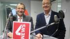 Das Bild zeigt SVP-Nationalrat Thomas Matter und Grünen-Nationalrat Louis Schelbert im SRF-Studio in Bern.