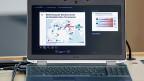 Auf dem Bildschirm eines Laptops steht «Bedrohung der Schweiz durch dschihadistischen Terrorismus».