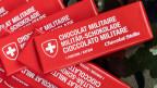 Wer seine Schoggi als «Swiss Army Chocolate» schmücken will, muss dem Bund eine Lizenzgebühr bezahlen.