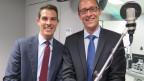 FDP-Nationalrat Thierry Burkart (links) und CVP-Nationalrat Martin Candinas diskutieren im Radiostudio Bern über Post-Grundversorgung.