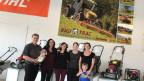 Mitarbeiterinnen und Mitarbeiter des Unternehmens Rigitrac.