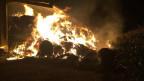 Eine Scheune steht in Flammen, am Samstag, 29. Juli 2017, in Domdidier.