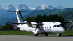 Ein Flugzeug der Skywork Airlines auf dem Flughafen Bern Belp.