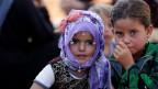 Vertriebene syrische Kinder in einem Flüchtlingslager in Atimah, Provinz Idlib, Syrien.