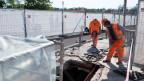 Bausarbeiter auf einer Baustelle in der Schweiz.