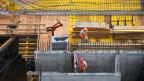 Bauarbeiter auf einer Baustelle in der Schweiz.