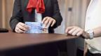 Symbolbild einer Bankangestellten.