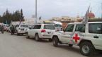Ein Autokonvoi vom IKRK unterwegs in Syrien.