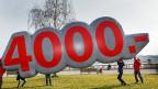 Unia-GewerkschafterInnen demonstrieren in Genf für ihre Mindestlohn-Initiative.