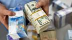 Schon wieder stehen Schweizer Banken im Verdacht, geschummelt zu haben: Die Wettbewerbskommission untersucht, ob sie sich bei Wechselkursen abgesprochen haben.
