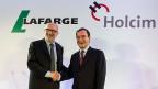 Am 14. April 2014 schien die Welt für die zwei Zementriesen noch in Ordnung: Holcim-Verwaltungsratspräsident Rolf Soiron und Lafarge-Chef Bruno Lafont.