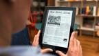 NZZ online auf einem Tablet.