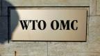 Logo der WTO am Hauptsitz in Genf.