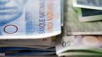 Die Bussen im Steuerstreit zwischen der Schweiz und USA fallen für viele Schweizer Banken kleiner aus als erwartet.
