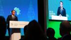 WTO-General-Direktor Roberto Azevedo steht am Rednerpult und spricht in ein Mikrofon.