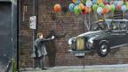 Werden fliegende Taxis schon bald Realität? Wandgraffiti in Glasgow.