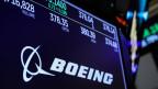 Firmenlogo und Handelsinformationen für Boeing auf dem Bildschirm der New Yorker Börse im März 2019.