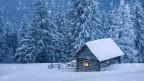 Gemütlich zu Hause sitzen während es draussen schneit.