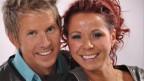 Ein lachendes Paar auf dem offiziellen Pressefoto.