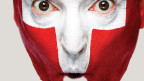 Marco Rima mit geschminktem Gesicht: Schweizerflagge.