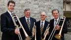 Vier Musikanten mit ihren Blasinstrumenten.