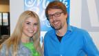 Gruppenfoto mit Interviewgast und Moderator.