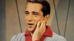 Perry Como mit erstauntem Blick.