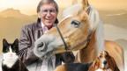Jonny Hill mit Hund, Katze und Pferd.