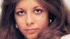 Junge Frau mit brünetten Haaren.